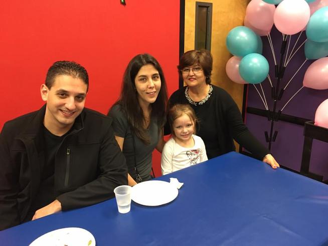 At a birthday party with our niece and Anna's mom.  En una fiesta de cumpleaños con la madre de Anna y sobrina.