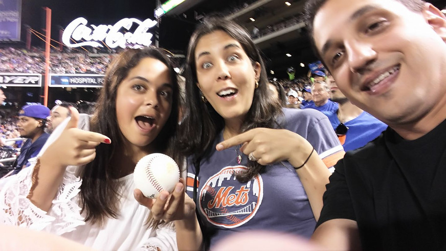 Catching a foul ball at the Mets game with Anna's cousin from Ecuador
