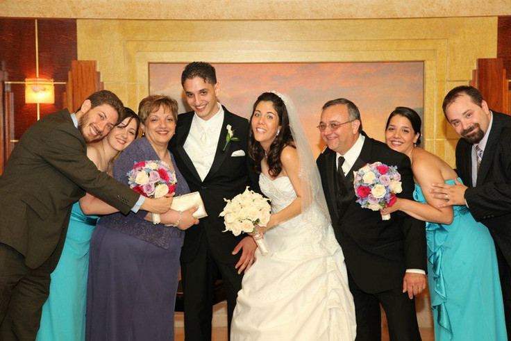 Celebrating with Tom's parents, sisters, and brothers-in-law