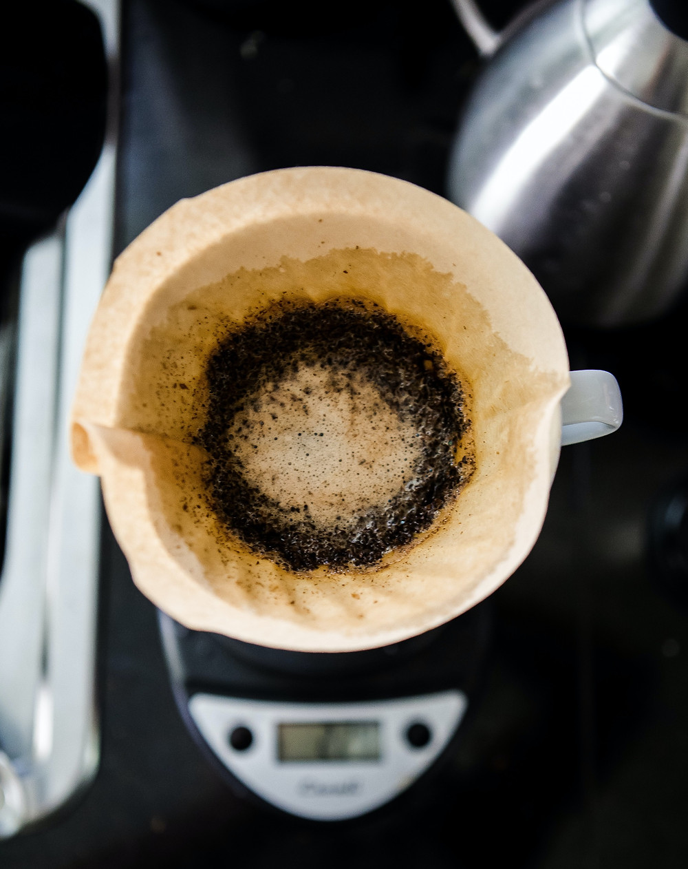 Leftover coffee grounds in coffee machine