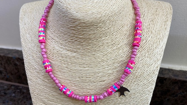 Pink beaded necklace with silver swallow charm