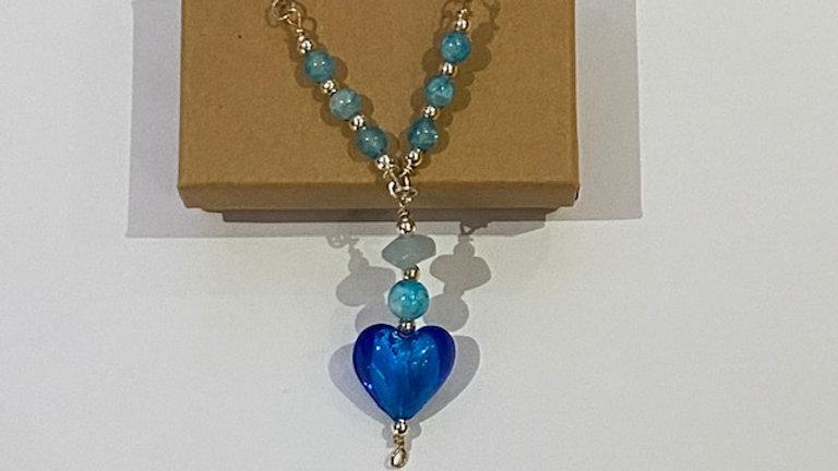 Bright blue heart pendant