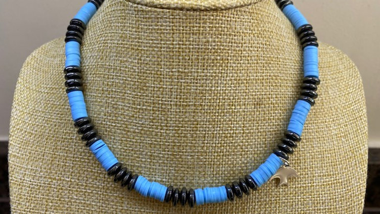 Blue and black beaded choker with silver charm
