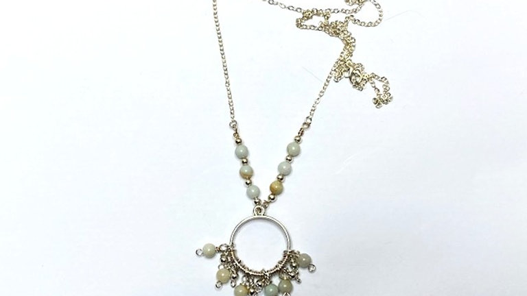 Beautiful pastel hanging beads on round pendant