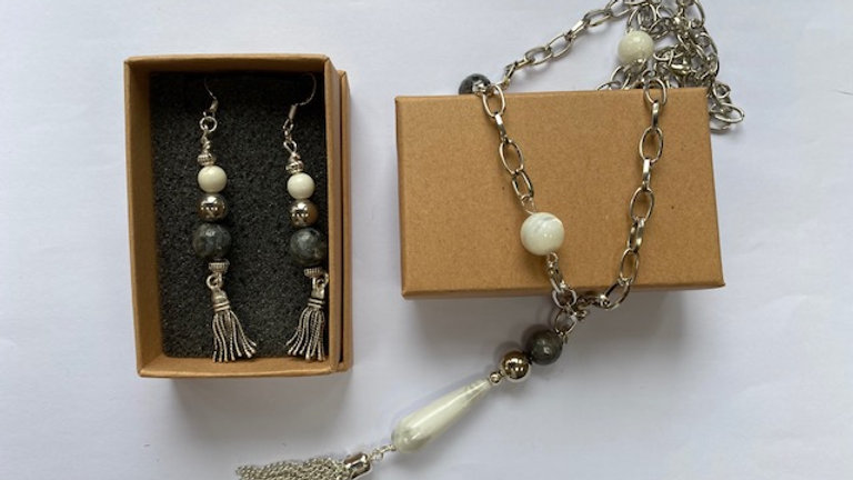 Matching dark grey and white pendant and earring gift set