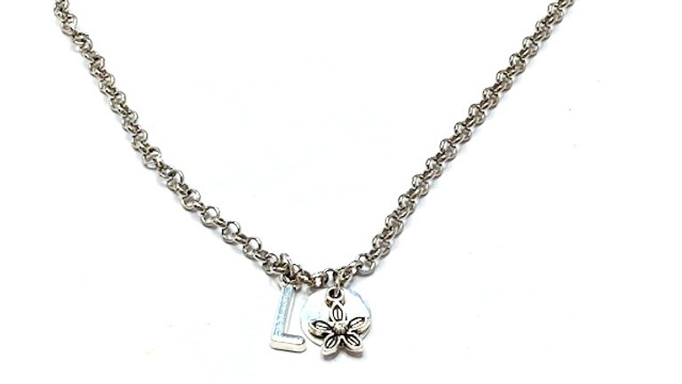 Silver chain with initial letter round disc and flower charms