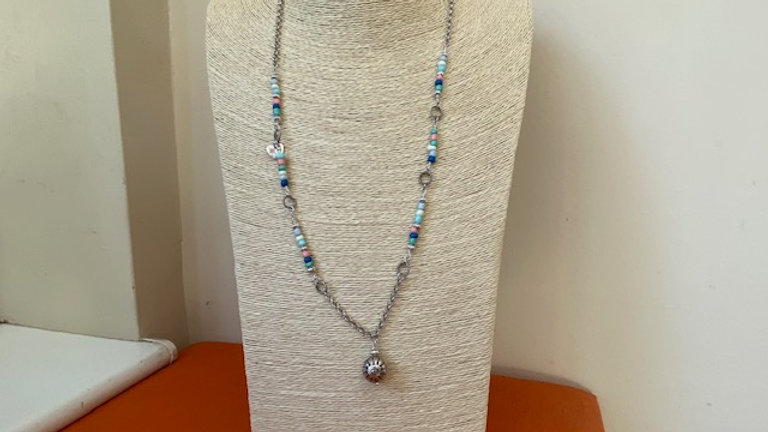 Long pendant with mixed beads and silver pendant charm