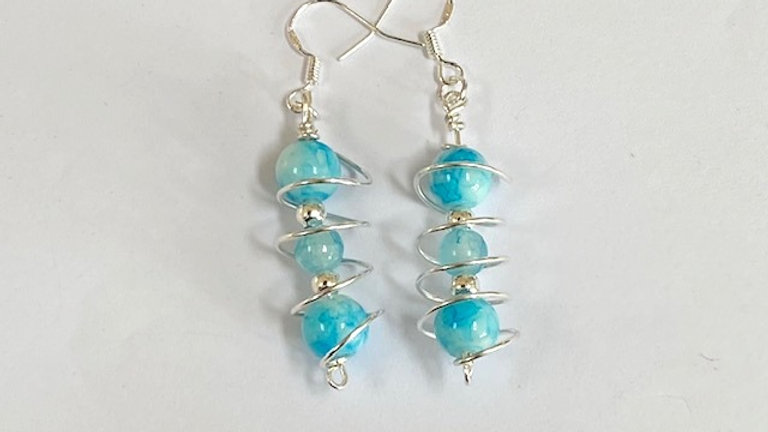 Blue dyed porcelain and glass caged earrings