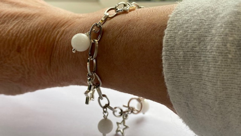 Silver charm bracelet with stars and jade beads