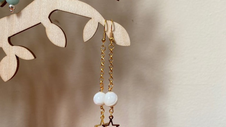 Gold dangly mother of pearl and star earrings