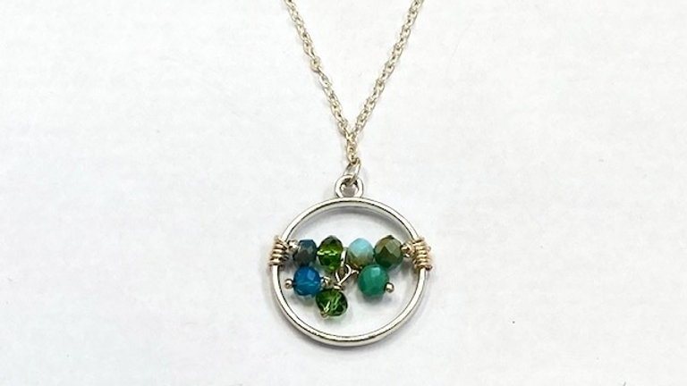 Round blue and green beaded pendant