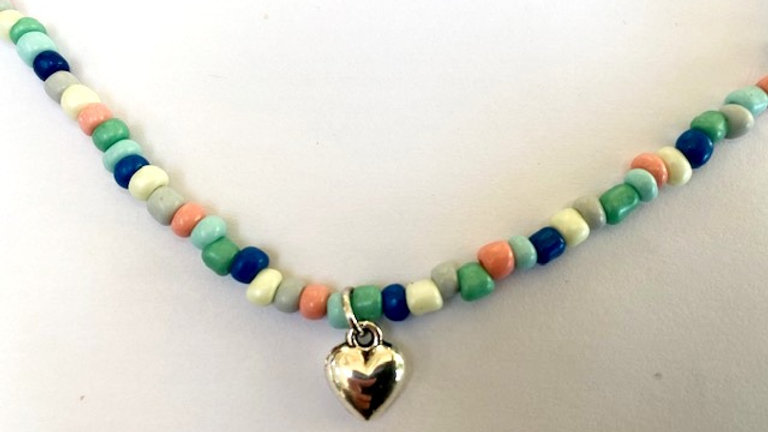 Seed bead necklace with silver heart charm