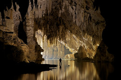 See a cave filled with stalagmites
