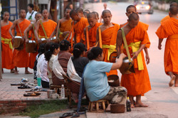 Give morning alms to the monks