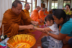 Receive a blessing from monks