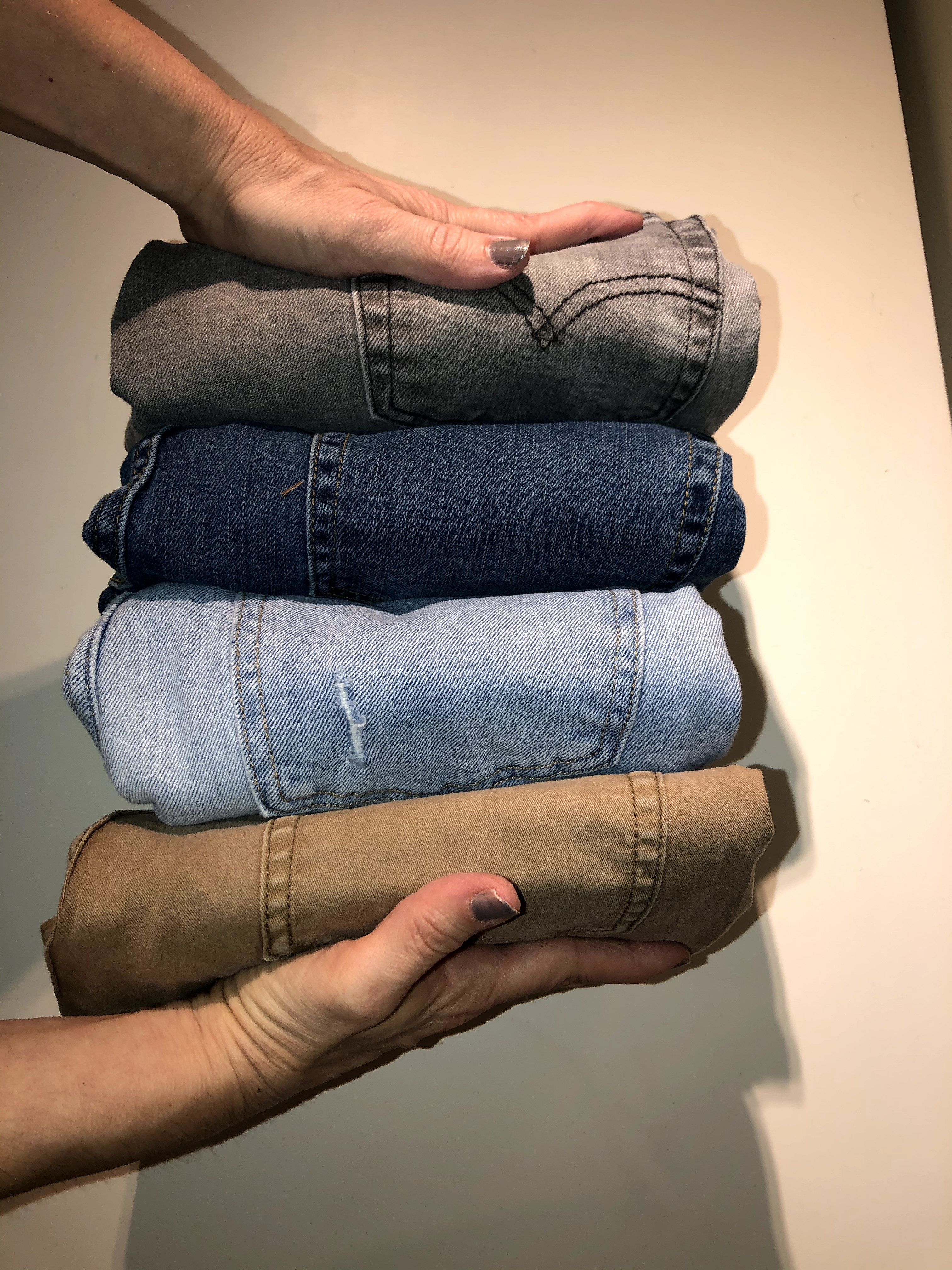 Jeans folding TIP. In order to fold jeans all you need is a shelf. fold it vertically.