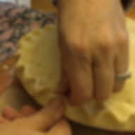 Gina's hands crimping a pie crust