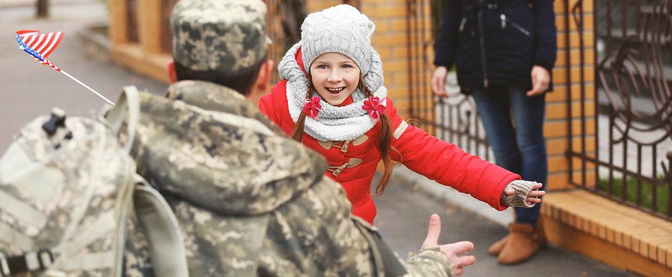 young girl greeting a war veteran