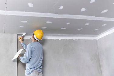 Craftsman working with plaster gypsum ce