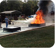 """Fire Fighting Training is offered for our customers, using Instruction with a """"Live Fire"""" Demonstration for your employees at your place of business."""