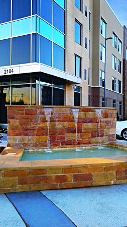 cambria-hotel-southlake-exterior-fountain-md