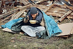 bigstock-A-Homeless-Man-Eats-Soup-From--