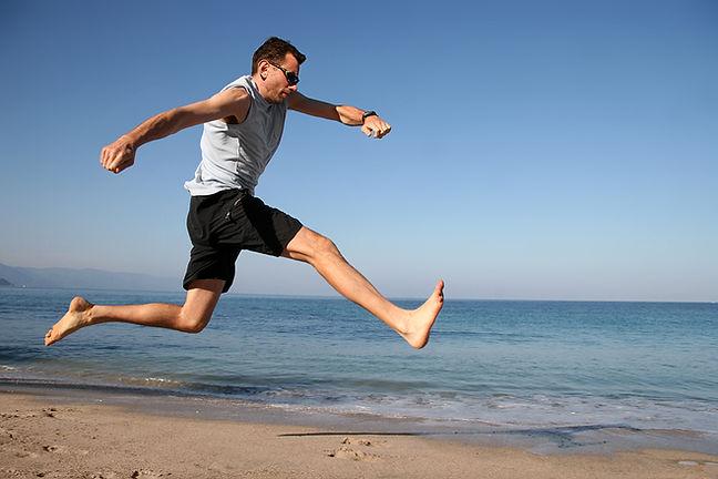 bigstock-Man-Jumping-On-The-Beach-105719