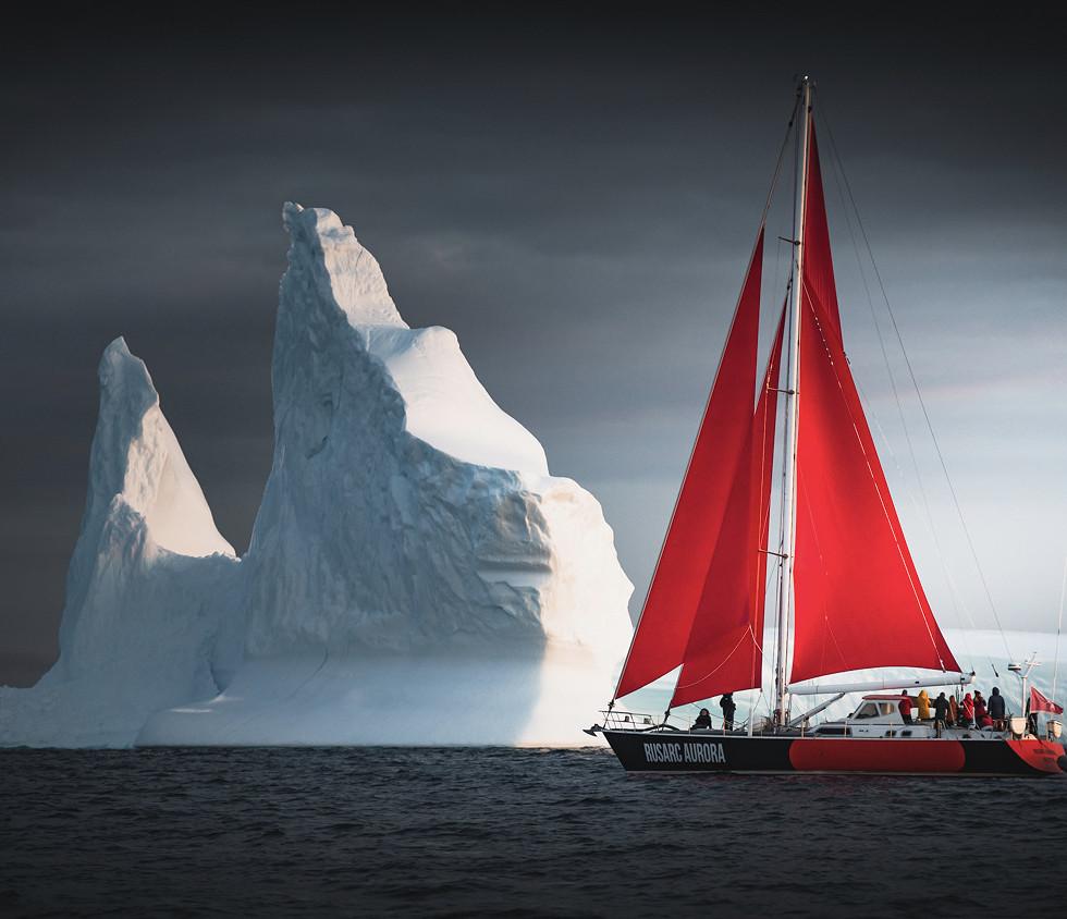 greenland-red-sailboat-iceberg.jpg