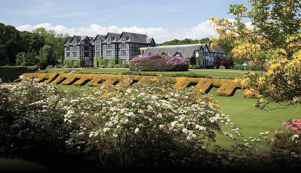 Gregynog Hall and its beautiful gardens on a sunny day