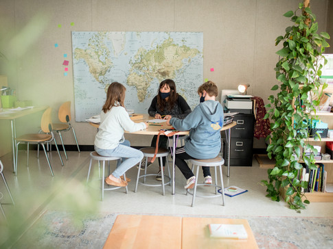 Girls Learning at Table