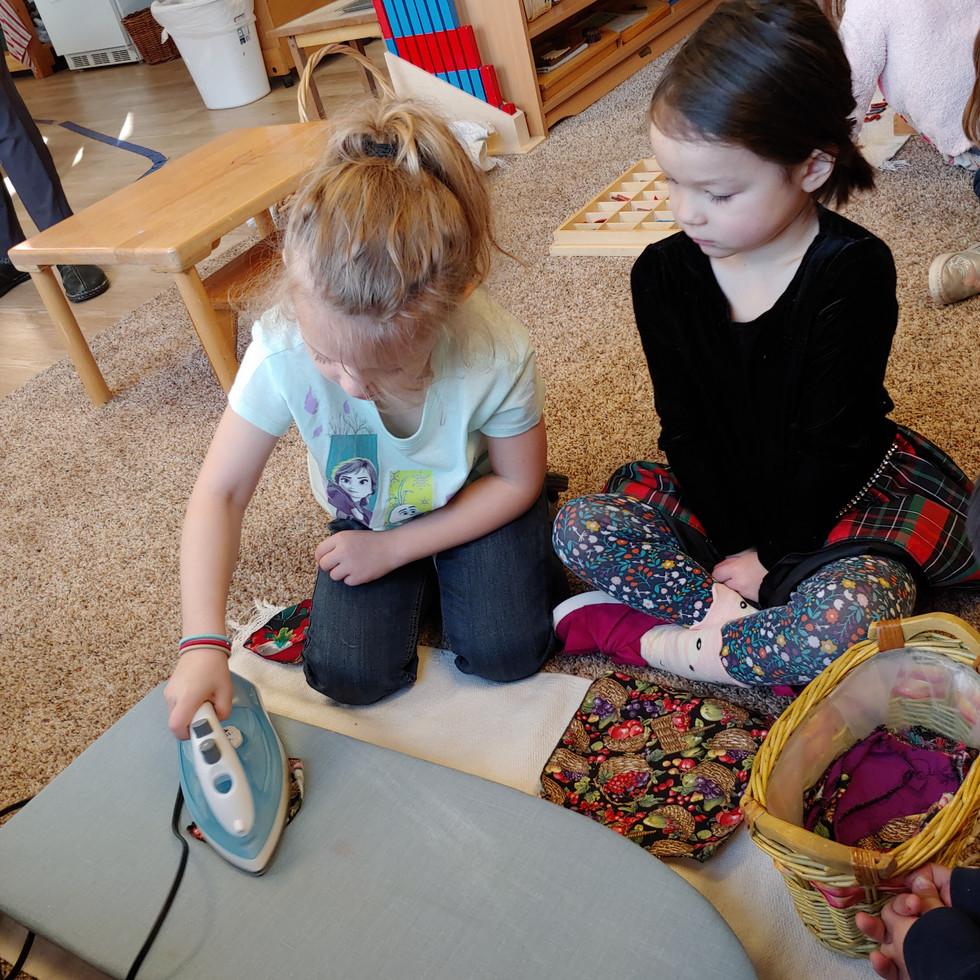 Two girls ironing.jpg