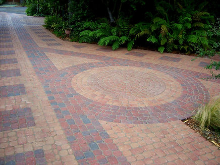 driveway with pavers in a circular pattern
