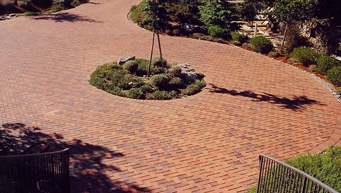 Red brick driveway with landscaping