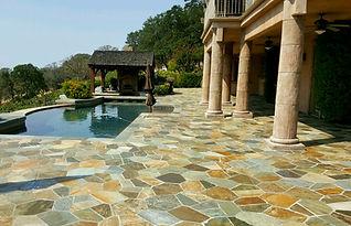 natural stone veneer patio with pool