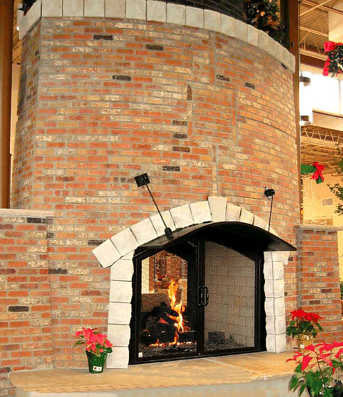 Large indoor  brick fireplace and poinsettias