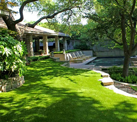 Stone house with grass yard and stone retaining walls
