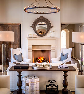 white room with stone fireplace and furniture
