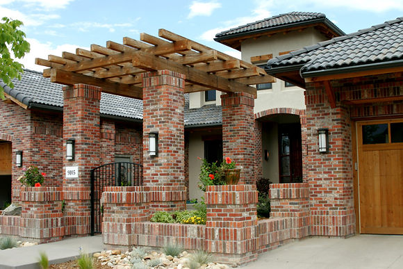 Brick and stucco house with pergola