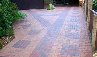 Driveway with red and gray pavers