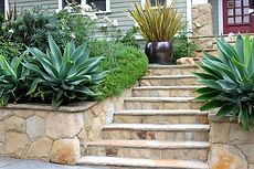 Flagstone stairs and wall with landscaping