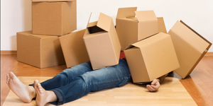 person buried under boxes