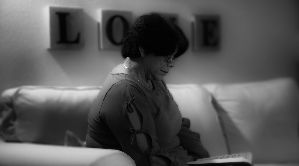 Woman reading Bible to learn to love