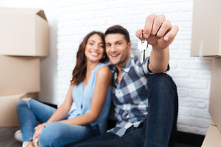Young married couple with boxes and hold