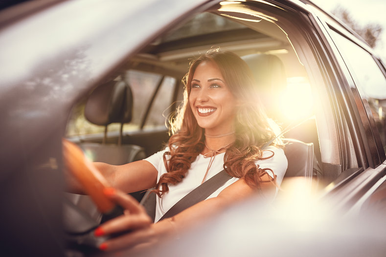 Beautiful young happy smiling woman driv