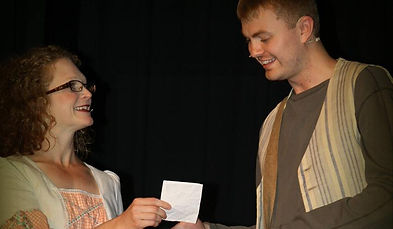 An actor passing a ticket to another - Image