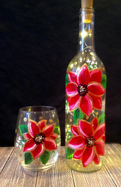 Holiday wine glass and bottle duo