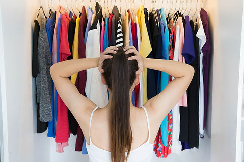 Woman Standing in Front of Closet.jpg
