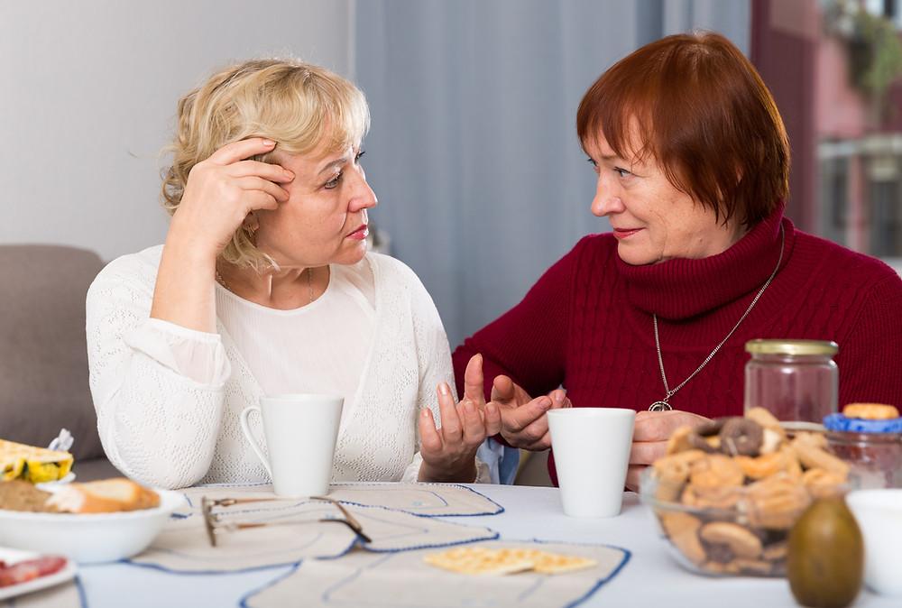 Two women displaying reflective listening skills