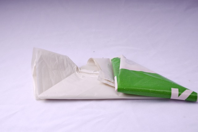 Fold the other side into a triangle