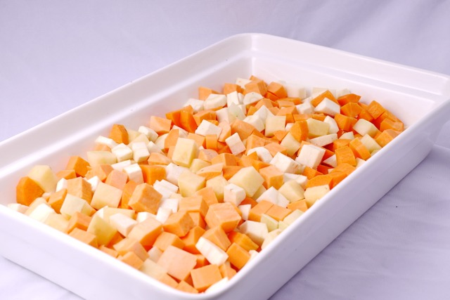 Root vegetables in an oven-safe dish